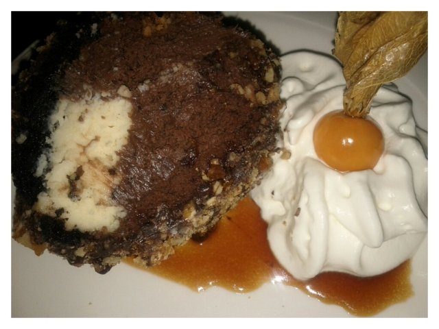 White and Dark Chocolate Cheesecake rolled in an Oreo Crust and finished with Praline