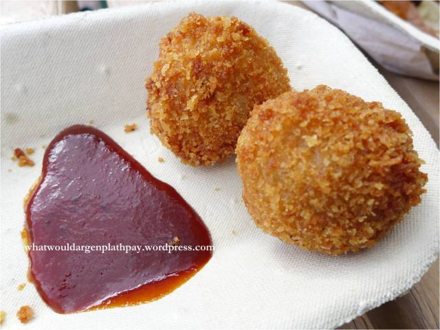 Pig Balls – risotto rice balls stuffed with pulled pork and caramelized onions, breaded and deep fried, finished with chipotle raspberry BBQ sauce
