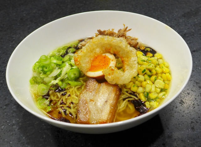 Alberta Pork Ramen - Shio broth with pork done three ways (char-siu style, shredded ham and shoulder, crispy chicharon), sweet corn, and umeboshi egg