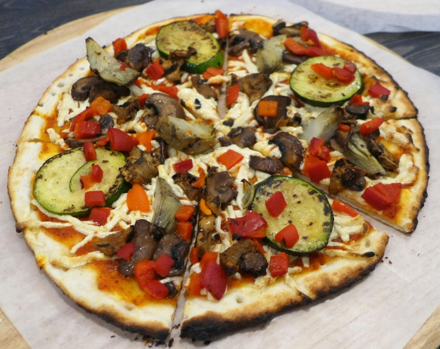 Garden Fire: Grilled Portobello, Grilled Zucchini, Roasted Red & Yellow Peppers, Grilled Artichokes, Grilled Eggplant, Fire-Roasted Tomato Sauce, Vegan Cheese