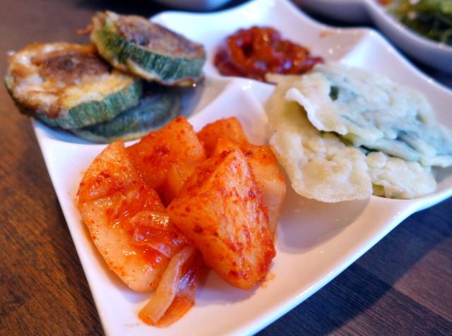 Banchan plate: Pickled Chinese radish, stuffed zucchini, spicy squid, green onion pancake