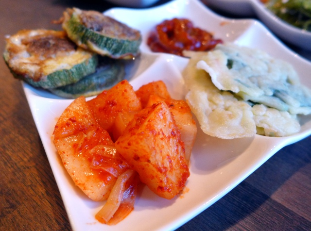 Banchan plate: Pickled Chinese radish, stuffed zucchini, spicy squid, green onion pancake