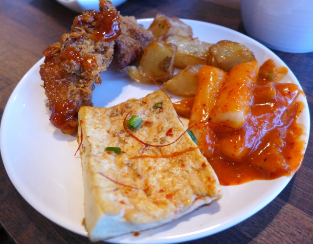 My buffet plate with pan fried tofu, fried chicken, garlic potatoes and ddukbokki