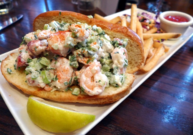 Lobster Roll: The Keg's version of an East Coast classic. A mix of lobster and shrimp on a butter-brushed brioche roll. Served with cabbage slaw and fries.
