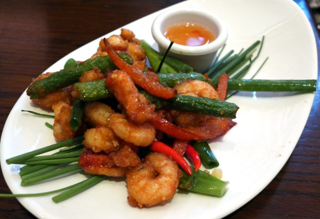 Szechwan Lobster: Golden fried lobster and shrimp with a mix of chili peppers, red peppers and asparagus. Tossed in a sweet and spicy sauce.