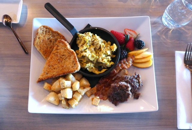 Cured Platter: 2 scrambled eggs, Cured signature bacon, breakfast sausage, confit hashbrowns, multigrain toast and fruit