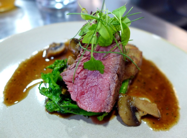 Flank Steak (marinated in beer) with a German bread dumpling with rapini, mushrooms and truffle