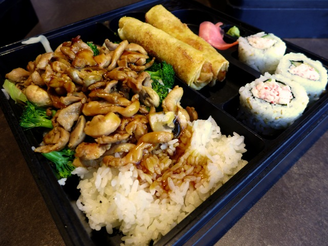 Chicken bento box with California Rolls and Dessert Spring Rolls