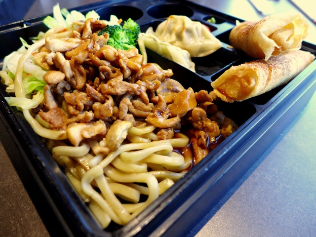 Chicken Yakisoba Bento Box with Gyoza and Dessert Spring Rolls