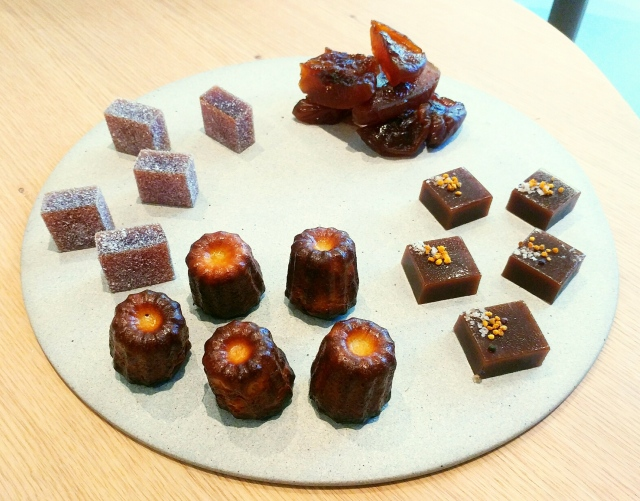 Post Dinner Treats (Clockwise, L to R): Sour cherry pate de fruit, Peach, cooked in sugar for 3 days, Buckwheat honey caramel, Amaro caneles