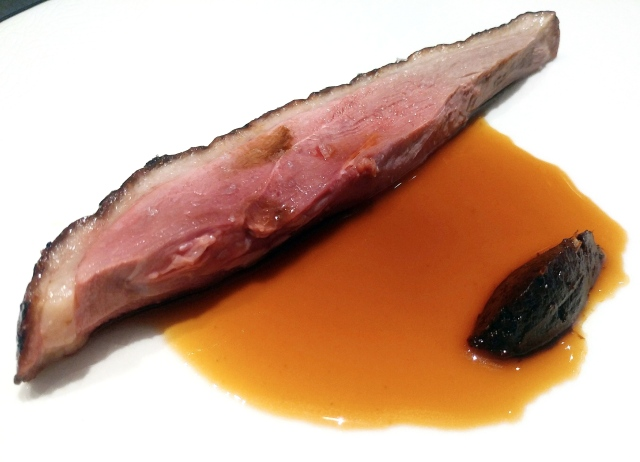 Peking duck glazed with beet juice along with caramelized tomato puree and duck juice