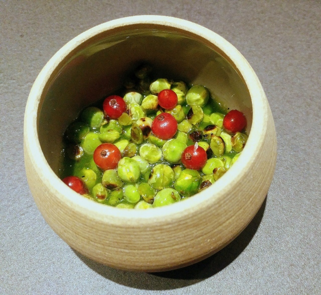 Grilled Spring peas in a sauce of their own shells with red currants and wild ginger root oil