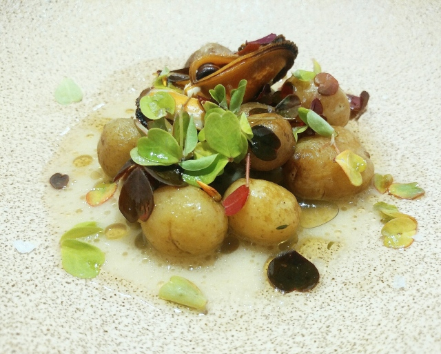 New potatoes in goat butter, mussels, oxalis and kombu oil