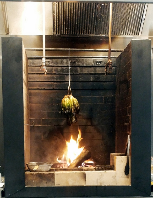 Romaine being cooked over fire
